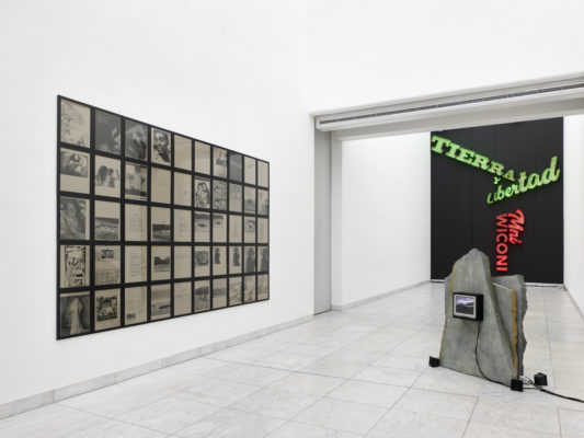 (left) Battlefields, Gardens and Graveyards (Sentimental Scrapbook displayed) 2002, 50 framed photocopies on paper; (right) After You've Gone 2002/2020 stone, screens, speakers; After you've gone & After you've gone (Bessie) 2002, videos. Photo: Achim Kukulies
